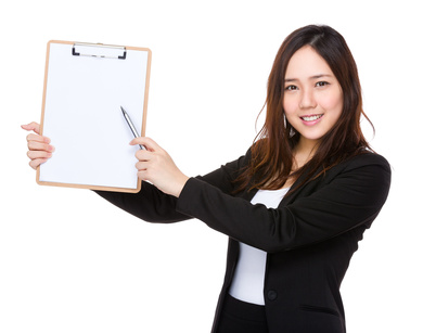 Asian businesswoman pen point to clipboard with blank paper